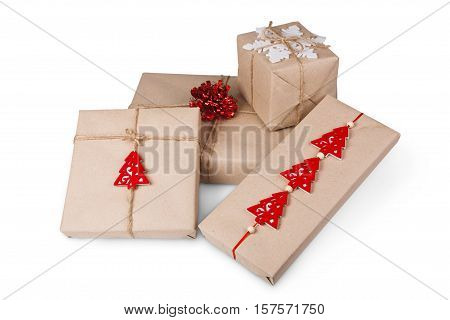 Gift boxes or mail parcels group, post delivery wrapped with kraft paper and twine, decorated with snowflake and red christmas trees isolated on white background. Craft present for winter holidays