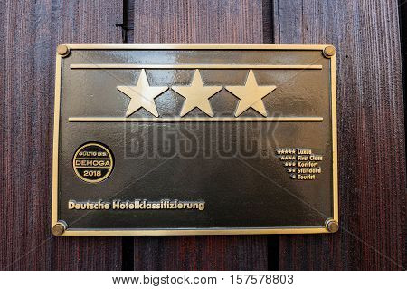 FREUNDESNTADT, GERMANY - 23 NOV 2016: Hotel star rankings on three star German hotel facade - five star for luxury four stars for first class three stars for comfort two stars for standart and one star for tourist deutsche hotelklassificazierung