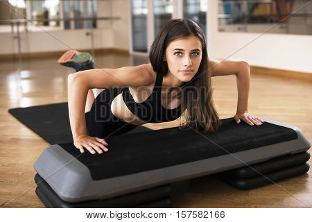 Gym Fitness Woman Working Out Doing Push-ups Strength Training Smiling Happy During Workout. Young M