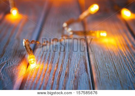 Luminous Christmas Garland On A Wooden Background.