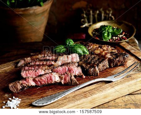 juicy grilled steaks on a cutting board