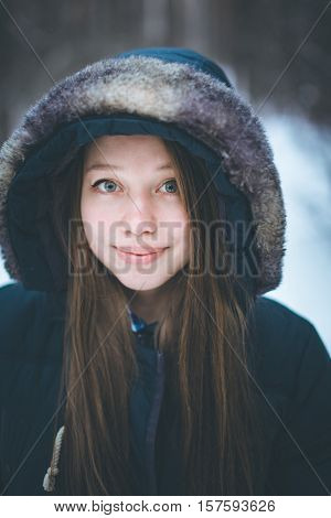 Headshot Of Young Beautiful Woman In Warm Clothes