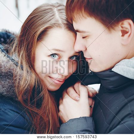 Couple In Love Hugging And Having Fun In Winter Forest