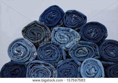 roll blue denim jeans â??gray background