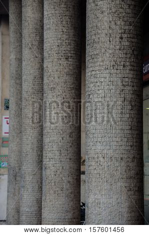 Several mosaic pillars in row made by stones