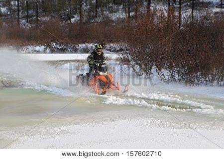 Snowmobiles will boost ice crust on the river in South Yakutia Russia