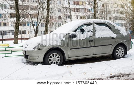 Smolensk, Russia - November 13, 2016: Renault Dacia Logan parked in winter near the house.