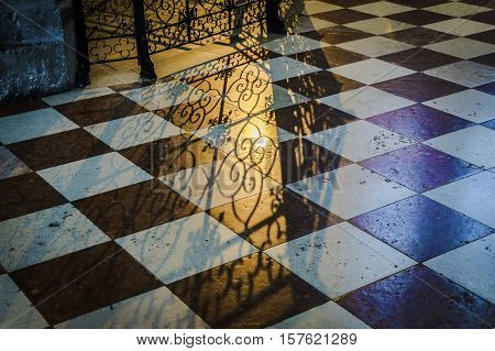 Detail shadow of a railing in a church in Vienna