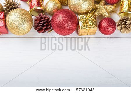 Christmas set Christmas toys space for text on the greeting card. gold and red toy.