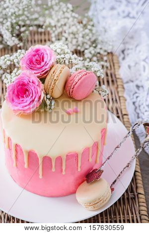 Homemade cake with pink frosting and white chocolate ganache made for Valentine's Day