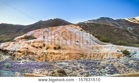 Mineral water stream covered the slope with travertine deposits, Cross Pass, Gudauri, Georgia. Europe.