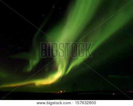 Breathtaking northern lights flashing on the autumn night sky, the southern part of Iceland