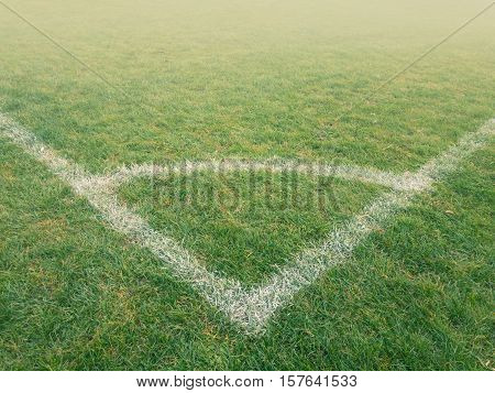 Corner arc of soccer pitch in the fog England.