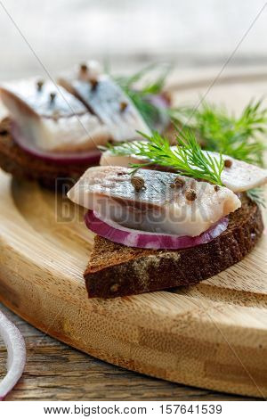 Appetizer Of Herring, Onion, Dill And Rye Bread.