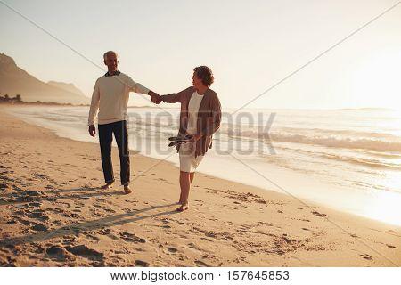 Playful Senior Couple On The Beach