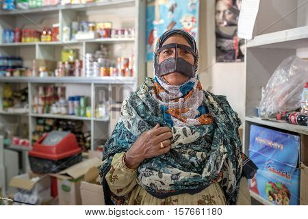 Qeshm, Iran - December 22, 2015: Bandari woman wearing a traditional mask called the burqa, Qeshm Island, Salakh, Iran
