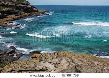 Bondi to Coogee coastal walk, Sydney, Australia. A cliff top coastal walk extends for 6 km in Sydney's eastern suburbs. The walk features stunning views, beaches, parks, cliffs, bays and rock pools