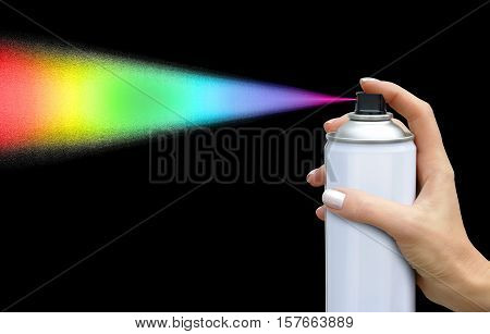 The color of the dispersion jet from an aerosol can in feminine hand on dark background