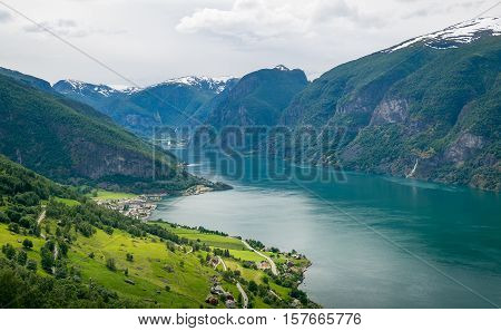 Norwegian fjord at cloudy day aerial view. Aurlandsvangen town, Sognefjord, Norway.