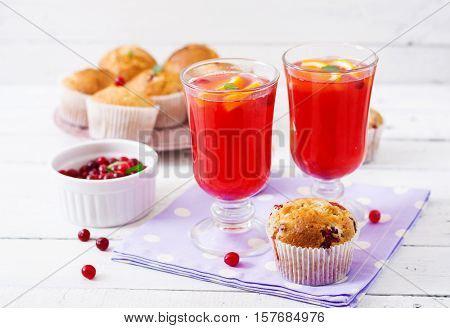Tasty Muffin (cupcake) With Cranberries And Cranberry-orange Drink.