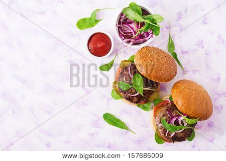 Big Sandwich - Hamburger Burger With Beef, Pickles, Tomato And Red Onions On A Light Background. Top