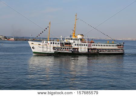 ISTANBUL TURKEY - SEPTEMBER 15 2016: Sehir Hatlari ferry carry passengers between Asian and European sides of Istanbul. Sehir Hatlari was established in 1844 and now carry 150000 passengers a day.