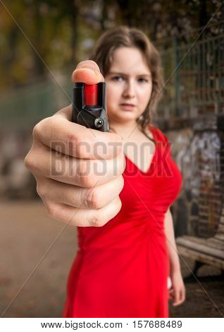 Self Defense Concept. Young Woman Holds Pepper Spray In Hand. Is