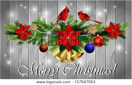 Christmas decoration with evergreen trees with balls gingerbread poinsettia golden bells on wood background with two cardinal birds