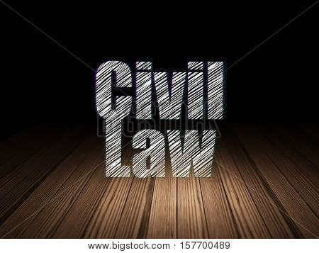 Law concept: Glowing text Civil Law in grunge dark room with Wooden Floor, black background