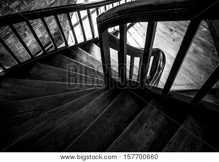 Wooden spiral staircase in old building Paris France.