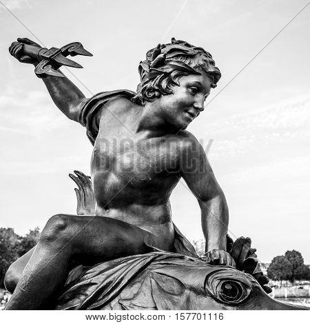 PARIS - FRANCE - AUGUST 30: Sculpture on Alexandre III bridge in Paris on August 30 2015 in Paris.