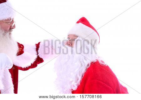 Santa Claus FIGHT! Two Santa Claus characters fight to the finish to see who is the Best Santa Claus of the season. Isolated on white with room for your text.  Santa Fight