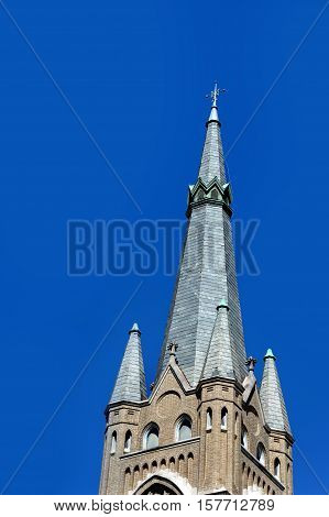Tall steeple of the St. Joseph Catholic Church in Greenville Mississippi is topped with an elegant cross.