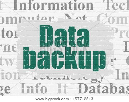 Data concept: Painted green text Data Backup on White Brick wall background with  Tag Cloud