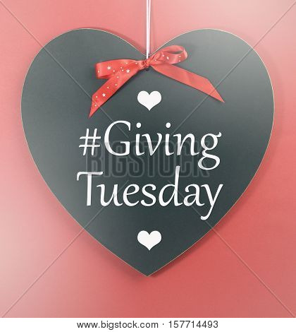 Giving Tuesday Message Greeting On Black Heart Shape Blackboard.