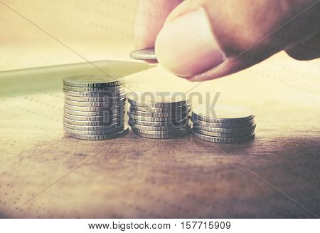 Double exposure stack of coins with account bank or bank book and account banking for finance concept, Money and saving and finance concept