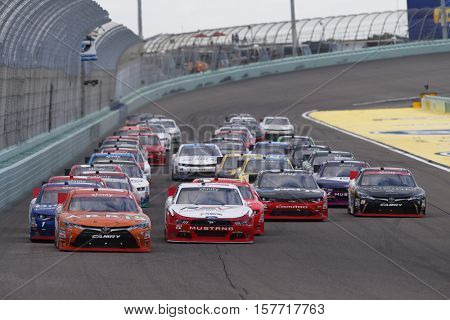 Homestead, FL - Nov 19, 2016: Daniel Suarez (19) battles for position during the Ford EcoBoost 300 at the Homestead-Miami Speedway in Homestead, FL.