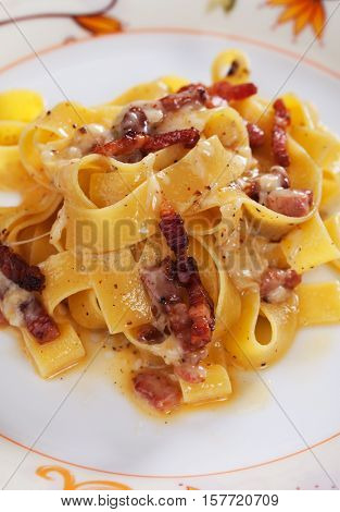 Italian pasta carbonara, pappardell with pancetta bacon, egg and cheese sauce