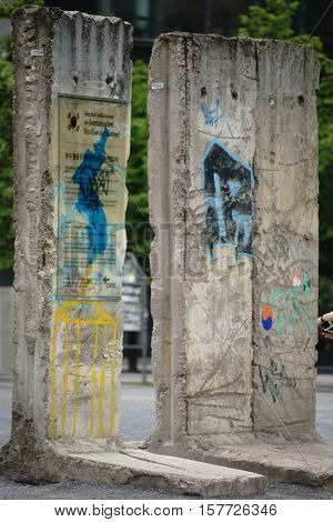 BERLIN, GERMANY - JUNE 21: Masonry remnants of the Berlin Wall standing on the Potsdam Square with a memorial tablet of the pavilion of the Korean Unity on June 21, 2016 in Berlin.