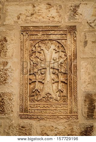 The Khachkar armenian cross-stone on the walls in the courtyard of the Cathedral of Saint James in the Armenian Quarter of Jerusalem Israel