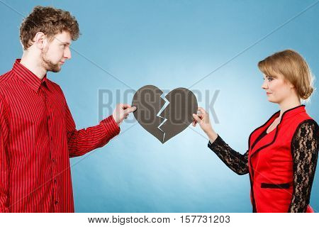 Young Pair Fixing Heart.