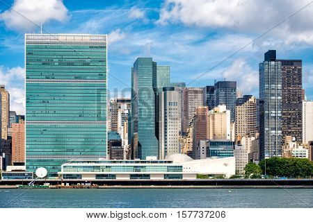 The United Nations Headquarters Building in midtown Manhattan, New York City on a beautiful summer day