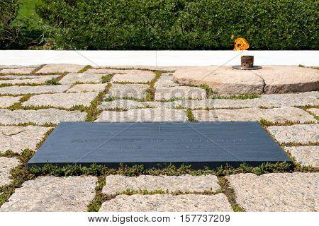 The Eternal Flame and the President John F. Kennedy tombstone at Arlington National Cemetery near Washington D.C.