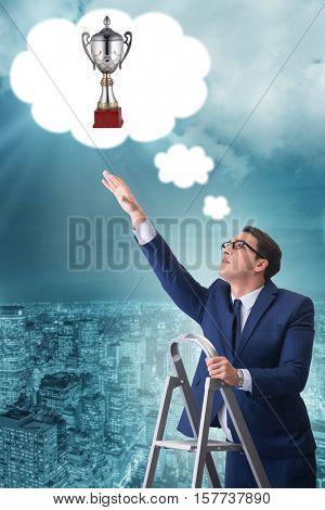 Businessman climbing towards his business goal