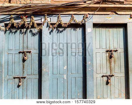Padlocked doors at Bhaktapur Nepal with wires and garland