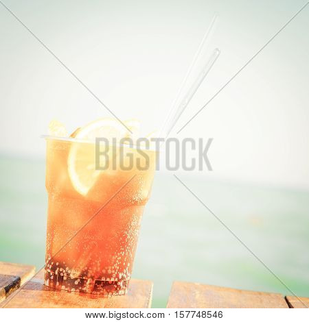 Concept Of Luxury Tropical Vacation. One Cuba Libre Cocktail On The Pier