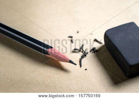 Pencil And Eraser On Brown Paper Mistake,risk, Erase Concept.