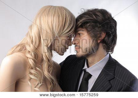 Businessman hugging a female mannequin