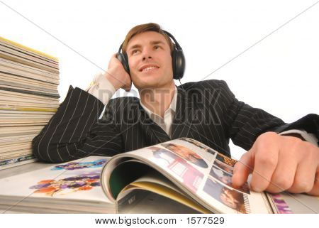 Businessman With Pleasure Listens To Music