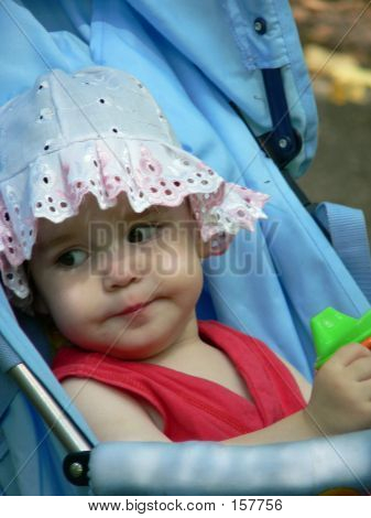 Toddler Sitting In A Baby Carriage